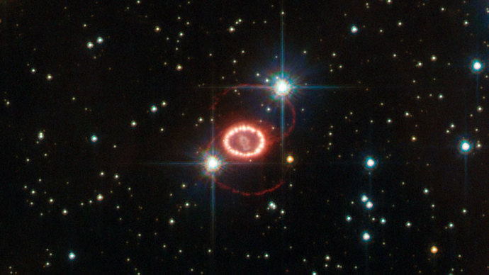 The still unraveling remains of supernova 1987A are shown here in this image taken by NASA's Hubble Space Telescope. The bright ring consists of material ejected from the dying star before it detonated. The ring is being lit up by the explosion's shock wave.Image credit: ESA/Hubble & NASA