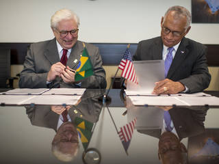 Brazilian Space Agency (AEB) President José Raimundo Braga Coelho, left,  and NASA Administrator Charles Bolden sign agreements to further research into heliophysics and space weather and to enhance global climate study and educational opportunities, Tuesday, June 30, 2015 at NASA Headquarters in Washington. Photo Credit: (NASA/Bill Ingalls)