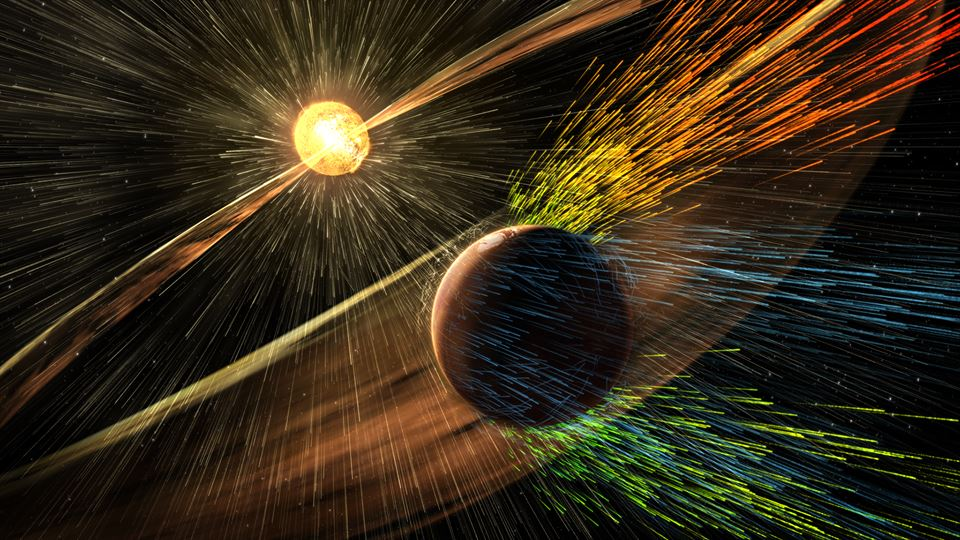 This image is an artist's rendering of a solar storm hitting Mars and stripping ions from the planet's upper atmosphere. Credits: NASA/GSFC